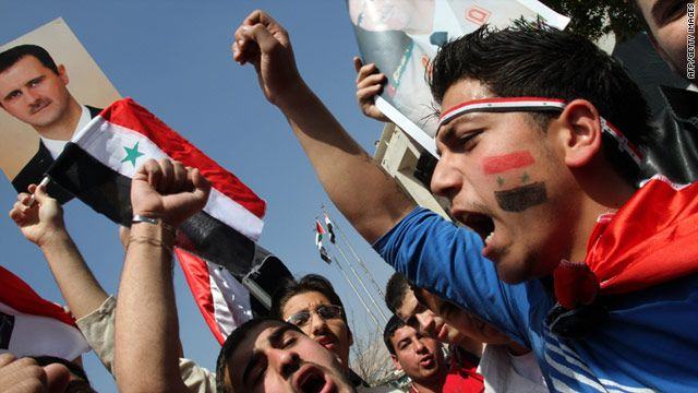Protesters express their disdain for President al-Assad and the Syrian government in light of recent events.