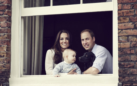 Duke and Duchess of Cambridge and Prince George posing for their most recent family portrait.
