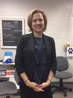 Noto poses for one of her last photos at Potomac Falls. Noto will end her term as principal on Jan. 27.