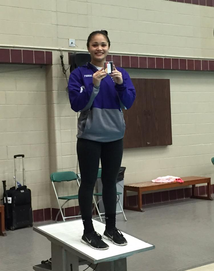 Fie'eiki stands on the platform holding her state medal from last year's competition. She was to repeat her dominating performance this year. Photo courtesy of Charlotte Fie'eiki