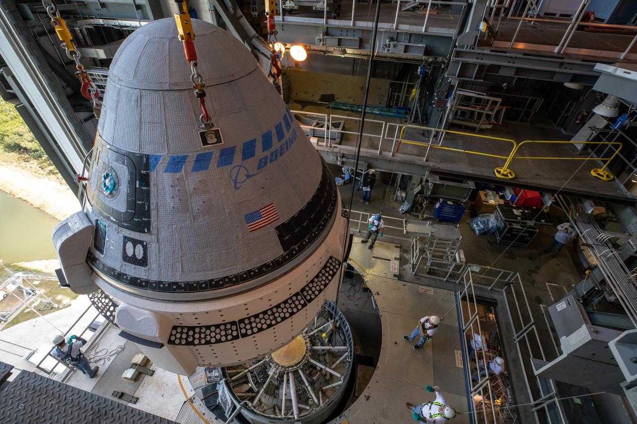 The first Boeing CST-100 Starliner is prepared to mate to the Atlas V rocket inside the Vertical Integration Facility at SLC-41 on Nov 21. Photo Credit: NASA/Cory Huston.